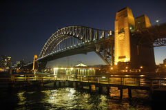 Harbour Bridge at night. Harbour Bridge in Sydney; night scene; wooden wharf in foreground Royalty Free Stock Photography
