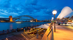 Harbour Bridge and Opera House in Sydney at dusk Stock Photo