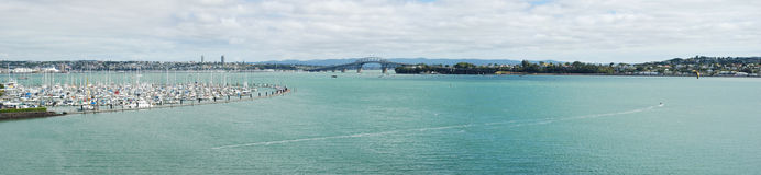 Harbour bridge panoramic view in Auckland. Harbour bridge panoramic view from Takapuna suburb, Auckland, New Zealand Stock Image
