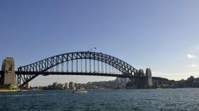 Harbour bridge,  Sydney. Small motor boat passing in front of the Harbour bridge in  Sydney, Australia Stock Photos