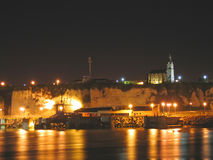 Harbour with a church. On a cliff in the night - Dieppe - France Royalty Free Stock Image