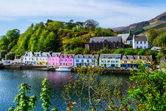 Harbour and colorful building in Potree, Isle Of Skye, Scotland. Scenic landscape view of colorful buildings/houses in harbour of Portree town on Isle Of Skye in royalty free stock photos