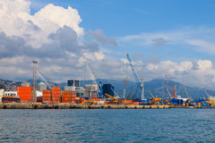 Harbour with containers and cranes view from the sea. Royalty Free Stock Photos
