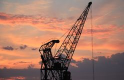 Harbour Crane, Sunset, Sky, Clouds Stock Photography