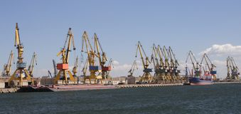 Harbour cranes. Unloading iron ore in Constanta city, located at the Black Sea stock photography