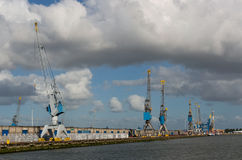Harbour cranes in Rotterdam port Royalty Free Stock Photography