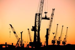 Harbour cranes sunset Stock Image
