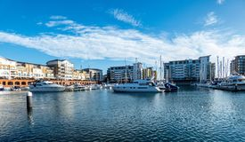 Harbour in Eastbourne with yahts, blue sky and water royalty free stock images