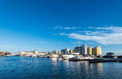 Harbour in Eastbourne with yahts, blue sky and water royalty free stock photos