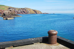 Harbour entrance, cliif and rocks at St. Abbs, Berwickshire. The harbour entrance, cliifs and rocks at St. Abbs in Berwickshire Stock Photo
