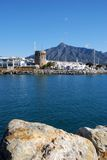 Harbour entrance, Puerto Banus, Marbella, Spain. Harbour entrance with the watchtower to the left and La Concha mountain to the rear, Puerto Banus, Marbella Royalty Free Stock Photos