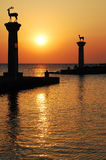 Harbour gates & Lighthouse, Rhodes, Sunset Stock Photography