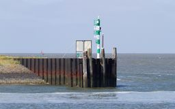 Harbour green starboard marker - Navigation light. Dutch harbour royalty free stock photos