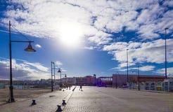 Harbour harbor walk backlit sun Royalty Free Stock Image