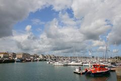 Harbour of Honfleur in France. Harbour in Honfluer France Normandy with Sailing and fishing boats Royalty Free Stock Photo