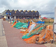 Harbour huts boats and nets Royalty Free Stock Images
