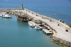 The harbour of Kyrenia, Cyprus. KYRENIA - JULY 17: The harbour of Kyrenia with her historical Ventian walls on July 17, 2012 in Kyrenia, Cyprus. The harbour Royalty Free Stock Photos