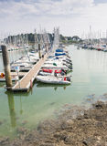 Harbour, La Trinité sur Mer. LA TRINITÉ SUR MER, FRANCE – JULY 24, 2014: Moored yachts and boats in the harbour on a sunny day stock photo