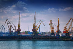 Harbour Level Luffing Cranes in Port Royalty Free Stock Photos