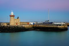 Harbour lighthouse at night. Howth. Dublin. Ireland. Harbour lighthouse at night. Howth. county Dublin. Ireland Royalty Free Stock Photo