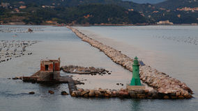 Harbour Limits. Outer harbour wall at La Spezia, Italy, with starboard hand marker Stock Images
