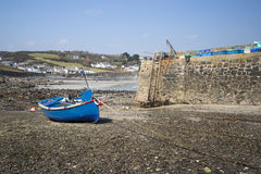 Harbour at low tide with fishing boats Stock Images