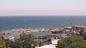 Harbour and medieval castle in Kyrenia city, Cyprus, Scenic view of Kyrenia, Old Harbour. A small bay for ships, Parking stock video footage