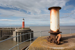 Harbour with mooring post and harbour light Royalty Free Stock Photos