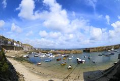 The harbour at Mousehole, Cornwall, England. The famous harbour at Mousehole, Cornwall, England.  Fisheye image Stock Photo