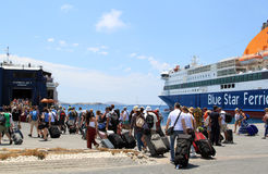 Harbour at Mykonos, Greece. People with luggage are heading to the Blue Star Ferries at Mykonos, Greece Stock Image