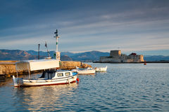 Harbour in Nafplio, Greece. Fishing boats in Nafplio harbour and Bourtzi castle, Greece royalty free stock photo