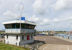 Harbour of Oudeschild. Harbour of the fishing village Oudeschild with harbour office on the isle of Texel stock image