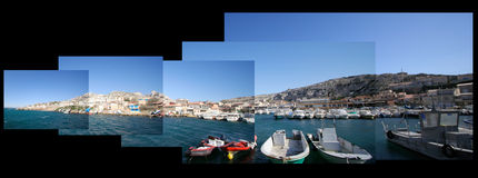 Harbour panorama. Multiple wide-angle shots of a small fishing vilage near marseille pasted together to make a wide panoramic image royalty free stock photos