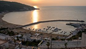 The harbour at Peschici, Puglia, Italy, photographed at sun down. Peschici is on the Gargano Peninsula stock image