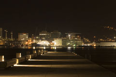 Harbour Pier At Night. A pier on Wellington harbour at night, looking across to the city centre Stock Photo