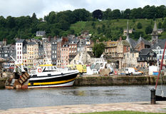 Harbour and Quay. In the Historic  Seaside Town of Honfleur in Normandy, France with a wooded Hillside in the background Stock Image