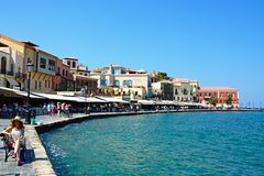 Harbour quayside buildings, Chania. Tourists walking along the restaurant lined quayside in the inner harbour, Chania, Crete, Greece, Europe Royalty Free Stock Image