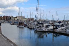 Harbour at Ramsgate in Kent. Yachts and boats in harbour with buildings in background Royalty Free Stock Image