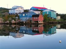Harbour reflections. A peaceful morning in the harbour of a small fishing comunity Stock Photography