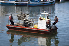 Harbour refuse patrol boat Royalty Free Stock Images