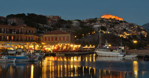 Harbour Restaurants Molyvos. Molyvos, Lesvos, Greece,- June 12, 2014: People dining at Harbour Restaurants Molyvos early evening royalty free stock image