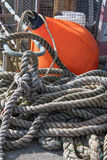 Harbour Scene with rope and orange buoy Royalty Free Stock Photography