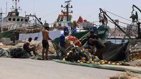 Harbour in the Sousse Tunisia. Fishermans. TUNISIA, SOUSSE, JULY 3, 2010: Fishermans in harbour in Sousse, Tunisia, July 3, 2010 stock footage