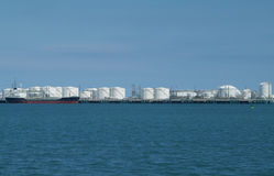 Harbour with storage tanks Stock Images