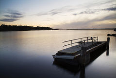 Harbour at sunset. Serene harbour with dock at sunset stock photography