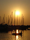 Harbour Sunset. Boats in the harbour as the sun is setting Stock Photo