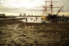 Harbour Sunset. Golden sunset over Portsmouth Harbour showing HMS Warrior Royalty Free Stock Images
