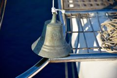 Ships bell on the bow of a yacht Royalty Free Stock Image