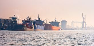 Harbour with tankers. On a colorful misty sunrise in september Stock Photo