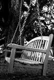Harbour Town bench. Black and white wooden bench on the old oak tree in the Harbour Town of the Sea Pines Resort on Hilton Head Island, South Carolina Stock Photography